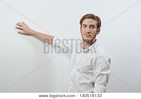 Young Adult Male Presenter in White Shirt Gesturing, Showing, Teaching