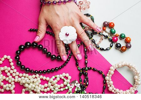 women's bijouterie, girl holding a colorful beads