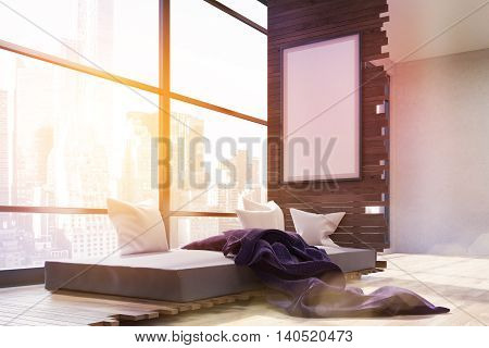Sunlit bedroom interior in big city. Panoramic window. Poster on wall. Gray bed with pillows and purple blanket. Concept of cozy bedroom in megapolis. 3d rendering. Mock up. Toned image.