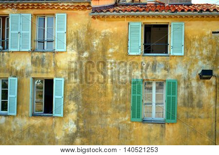traditional old french facade and windows in antibes france