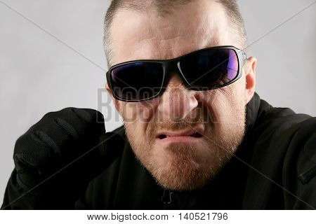 the a angry man in dark glasses