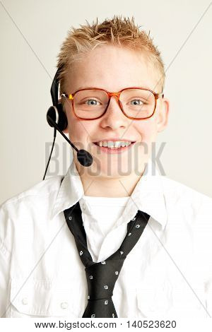 Smiling Boy Dressed As Businessman With Head Set