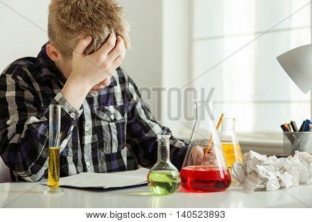 Stressed Teenage Boy Doing Chemistry Homework