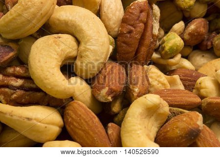This is a photograph of mixed nuts including Cashews,Almonds,Pistachios and Pecans