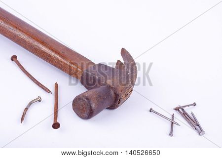 old Traditional curved claw hammer and rust nail tack used on white background tool isolated