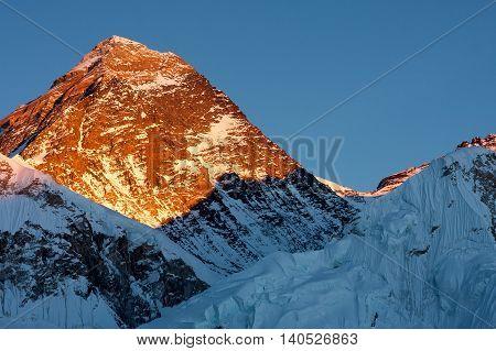 The last rays of sunlight on summit of Mount Everest.