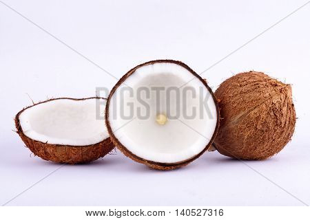 coconut half clipping path for coconut milk and brown coconut shell  on white background fruit food isolated