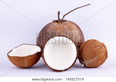 coconut half clipping path for coconut milk and brown coconut shell  on white background healthy fruit food isolated