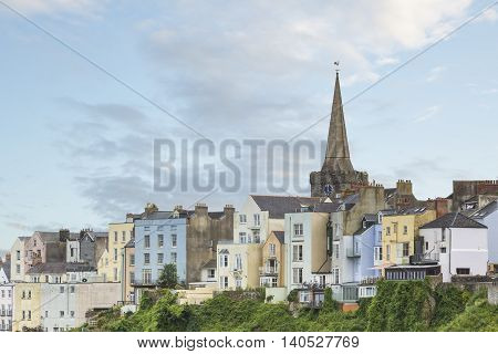 An image of the beautiful pastel colored buildings overlooking Tenby Harbour Tenby South Wales UK