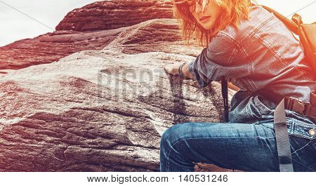 Asian woman enjoying the climbing natural stone Vintage picture.