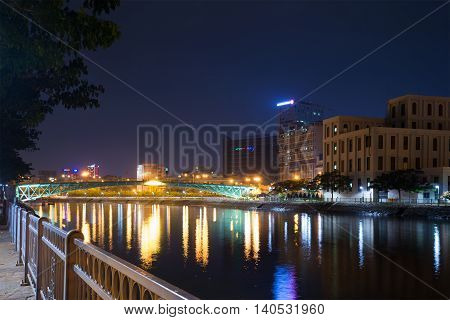 HO CHI MINH CITY, VIETNAM - DECEMBER 20, 2015: Late in the evening on the promenade. Tourist landmark of the city Ho Chi Minh City, Vietnam