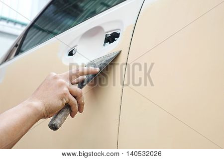 Car body work auto repair paint after the accident during the spraying