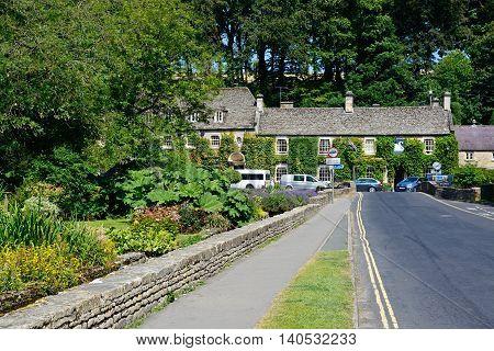 BIBURY, UNITED KINGDOM - JULY 20, 2016 - View towards The Swan Hotel Bibury Cotswolds Gloucestershire England UK Western Europe, July 20, 2016.