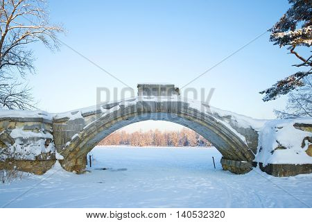 Arch of the old Humpback bridge closeup in the historical part of Gatchina, winter january day