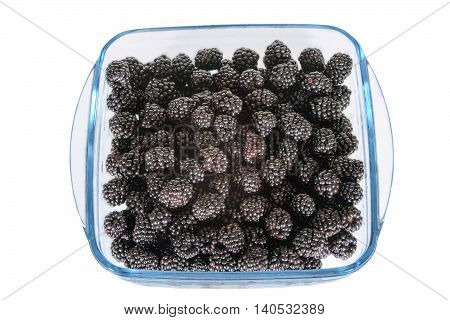 image on white background Glass dish with blackberries