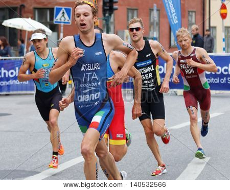 STOCKHOLM - JUL 02 2016: Running triathletes Uccellari Buchholz and competitors in the old town of Stockholm in the Men's ITU World Triathlon series event July 02 2016 in Stockholm Sweden