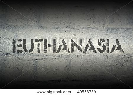 euthanasia word stencil print on the grunge white brick wall