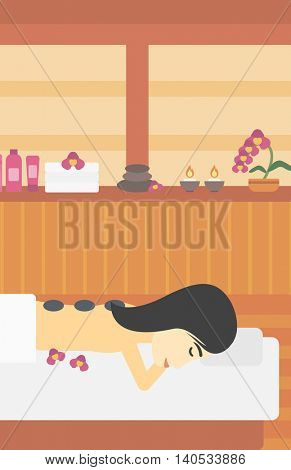 An asian woman relaxing while getting stone therapy massage in the spa center. Woman having back massage in the spa salon. Vector flat design illustration. Vertical layout.