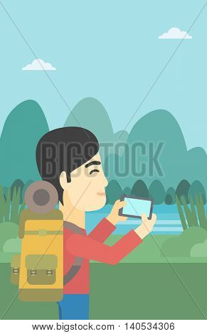 An asian man taking photo of landscape with mountains. Young man with backpack taking photo with his cellphone. Vector flat design illustration. Vertical layout.