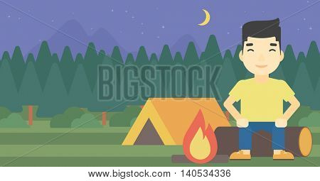 An asian travelling man sitting on a log near a fire on a background of camping site with tent. Man sitting near a campfire at a campsite. Vector flat design illustration. Horizontal layout.