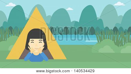 An asian woman crawling out from a camping tent. Travelling woman with her hands on cheek lying in camping tent and relaxing. Vector flat design illustration. Horizontal layout.