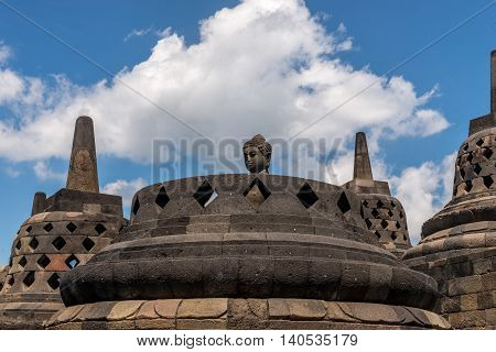 Borobudur Temple in Indonesia, clear day cloudy blue sky