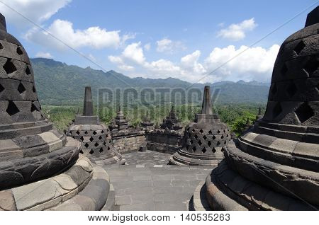 Borobudur Temple Indonesia clear blue sky with hills in the distance