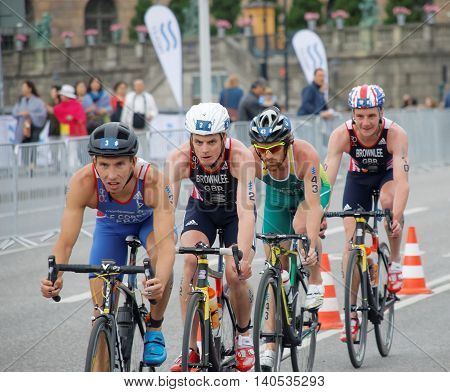 STOCKHOLM SWEDEN - JUL 02 2016: Brownlee brothers and group of colorful male triathlete cyclists in the Men's ITU World Triathlon series event July 02 2016 in Stockholm Sweden