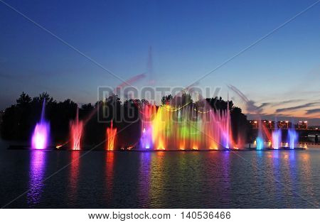 VINNYTSIA, UKRAINE - JUNE 30, 2012: Biggest fountain on the river in Vinnytsia, Ukraine. Located in the river Southern Buh fountain has a length of 140 meters