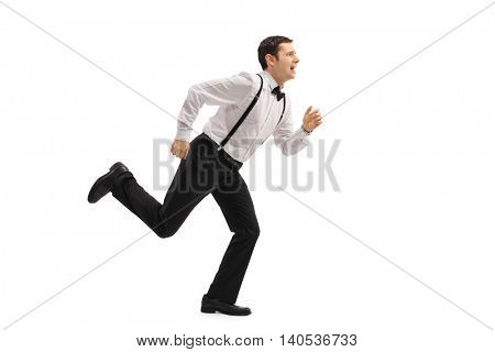 Full length profile shot of a well-dressed man running away from something isolated on white background
