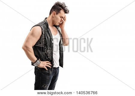 Disappointed young punk rocker holding his head in disbelief isolated on white background