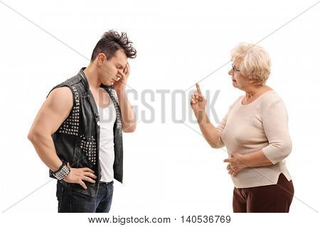 Senior woman arguing with a punker isolated on white background