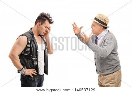 Young punker having an argument with a senior isolated on white background