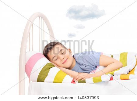 Happy boy sleeping and dreaming sweet dreams with a cloud above his head isolated on white background