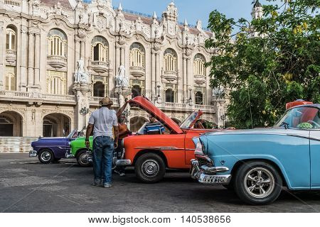 HAVANA, CUBA - JULY 05, 2015: American colorful vintage cars parked on the street before the Gran Teatro in Havanna Cuba