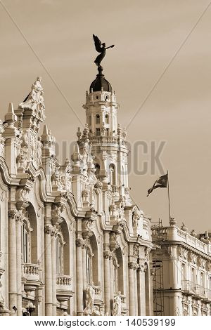 Gran Teatro in Havana Cuba with the fascade view and national cuba flag - sepia