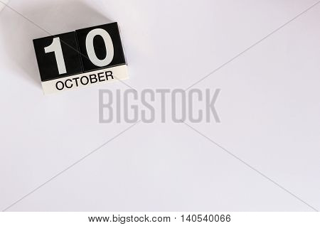 October 10th. Day 10 of month, wooden color calendar on white background. Autumn concept. Empty space for text.