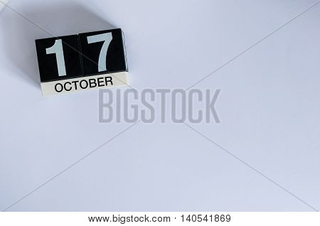 October 17th. Day 17 of month, wooden color calendar on white background. Autumn time. Empty space for text.