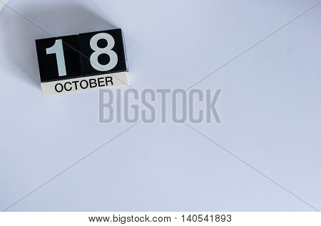 October 18th. Day 18 of month, wooden color calendar on white background. Autumn time. Empty space for text.