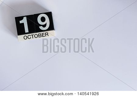 October 19th. Day 19 of month, wooden color calendar on white background. Autumn time. Empty space for text.