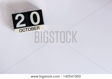 October 20th. Day 20 of month, wooden color calendar on white background. Autumn time. Empty space for text.
