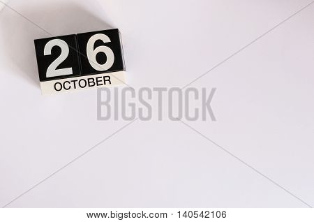 October 26th. Day 26 of month, wooden color calendar on white background. Autumn time. Empty space for text.