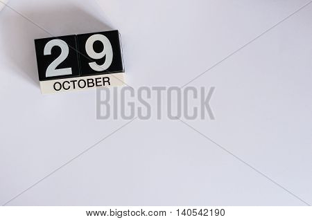 October 29th. Day 29 of month, wooden color calendar on white background. Autumn time. Empty space for text.