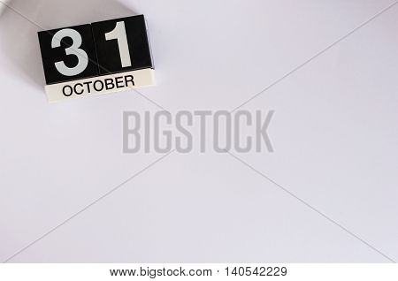 October 31st. Day 31 of month, wooden color calendar on white background. Autumn time. Empty space for text.