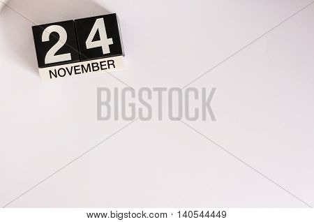 November 24th. Day 24 of month, wooden color calendar on white background. Autumn concept. Empty space for text.
