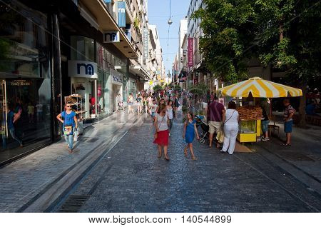 ATHENS-AUGUST 22: Shopping on Ermou Street with crowd of people on August 22 2014 in Athens Greece. Ermou street is a main shopping street in Athens.