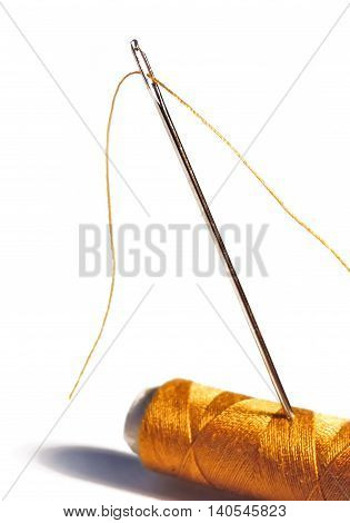 Sewing material, isolated on White. Needle and thread.