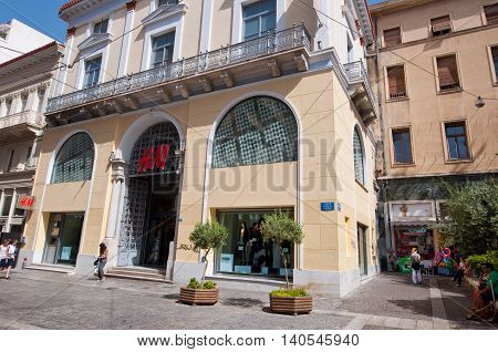 ATHENS-AUGUST 22: H&M store on Emrou street on August 222014 Athens Greece. H & M is a Swedish retail-clothing company known for its fast-fashion clothing for men women teenagers and children.