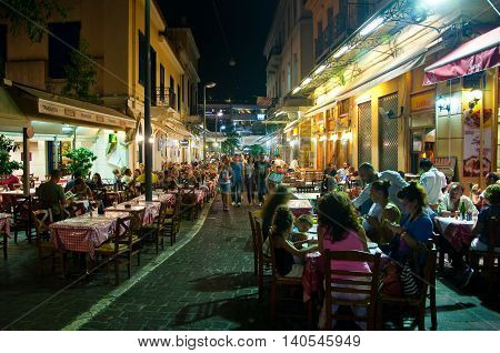 ATHENS-AUGUST 22: Street with various restaurants and bars on Plaka area near to Monastiraki Square on August 22 2014 in Athens Greece.