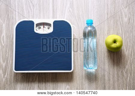 Floor scales on wooden background